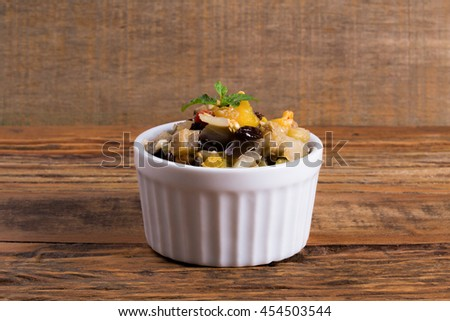 Aubergine with raisins grape and red peppers, yelow and green/ Aubergine/ Fresh food with Aubergine - stock photo