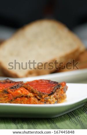 Aubergines parmigiana, typical italian vegan dish. - stock photo