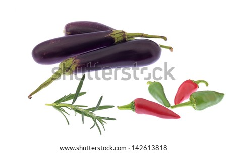 Aubergines with chillies and herb isolated on white background - stock photo