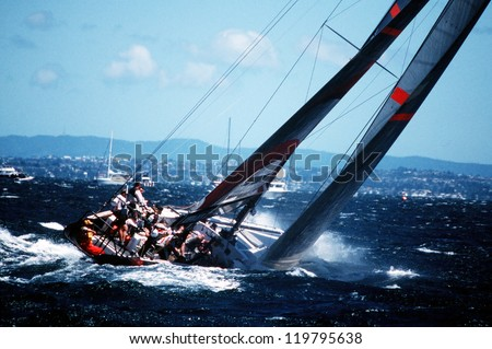 AUC - MARCH 1:Team Alinghi sails it yacht during the Americas cup of 2003 on March 01 2003 in Auckland New Zealand.It was contested between Team NZ and the winner of the 2003 Louis Vuitton Cup Alinghi. Best for smaller scale. - stock photo