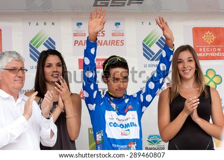 AUCH, FRANCE - JUNE 18:   The Colombian racer, Daniel Martinez , raises the arms on the podium of the first stage of the Route du Sud, on June 18, 2015 in Auch, France.