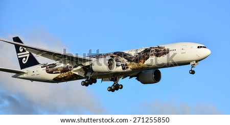 AUCKLAND - APR 13:Air New Zealand 777 plane landing in Auckland International Airport on APR 13 2015. 3 times winner of the best airline in the world. - stock photo