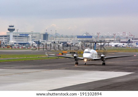 AUCKLAND - APR 10 2014:Jet aircraft on the runway of Auckland International Airport.It's the largest and busiest airport in New Zealand with 14,006,122 passengers in 2011 - stock photo