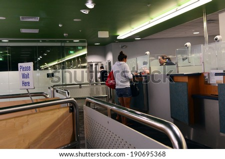 AUCKLAND - APR 10 2014:Passengers at New Zealand Customs and Border Protection checkpoint in Auckland airport.The agency responsible for the safety, security and commercial interests of New Zealand. - stock photo