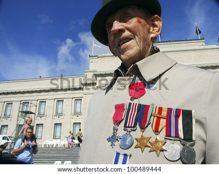 AUCKLAND - APRIL 25: A World War 2 veteran proudly displays his medals following the annual ANZAC Day remembrance service, on April 25, 2007 in Auckland, New Zealand. - stock photo