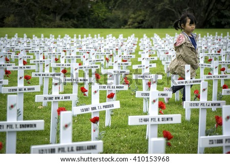 AUCKLAND - APRIL 24: White wooden crosses outside Auckland's War Memorial Museum commemorate the war dead, following an Anzac Day remembrance service on April 24, 2016 in Auckland, New Zealand. - stock photo
