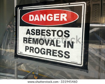 AUCKLAND - AUG 01 2015:Sign reads: Danger - Asbestos removal in progress.Inhalation of asbestos fibers can cause serious and fatal illnesses including lung cancer, mesothelioma and asbestosis. - stock photo