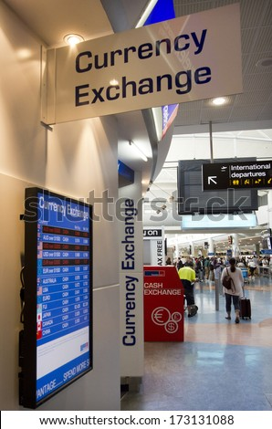 AUCKLAND - DEC 31: Currency exchange service  in Auckland airport on Dec 31 2013. In countries where currency exchange is lightly regulated they can be used as front organizations for money laundering - stock photo