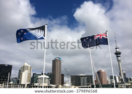 AUCKLAND - FEB 21 2016:New Zealand National flag (R) and the Silver Fern flag (L). After the final referendums voting in the end of March 2016 one of the flags will be the official flag of New Zealand - stock photo