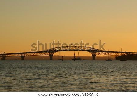 Auckland Harbour Bridge at sunset from devonport - stock photo