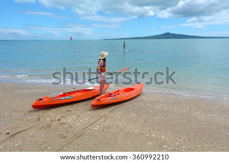 AUCKLAND - JAN 11 2016:Visitors in Mission Bay Beach.It's one of the most popular beaches and tourist attraction  in Auckland, New Zealand. - stock photo
