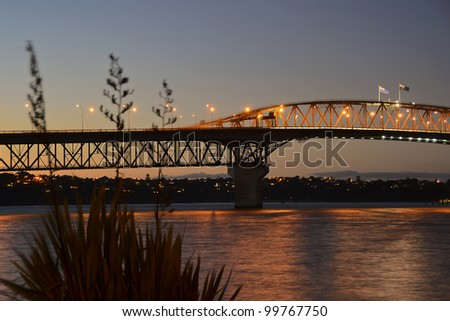 AUCKLAND, NEW ZEALAND - APRIL 10: Auckland Harbour Bridge is a popular destination and landmark in New Zealand's largest city (population 1.5 million), April 10, 2012 in Auckland, New Zealand. - stock photo