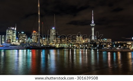 AUCKLAND, NEW ZEALAND Circa April 2014: the skyline of auckland reflecting in the water at the harbor