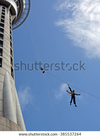 Auckland, New Zealand - February 27, 2016; Woman Bungy Jumping from the Auckland Sky Tower.