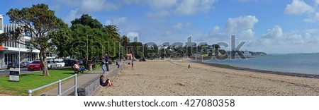 Auckland, New Zealand - May 22, 2016: Panoramic view of St Helliers Beach and people.  Auckland, New Zealand