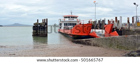 Auckland, New Zealand - October 03, 2016: Car Ferry berthed at Half Moon Bay at low tide. Ferries passengers and cars to Waiheke Island and Great Barrier Island.