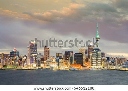 Auckland, New Zealand's largest city, under a dramatic twilight sky.