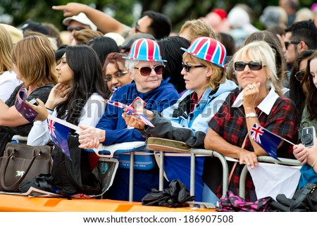 AUCKLAND, NZ - APRIL 11: Fans wait to be greeted by the Duke and Duchess of Cambridge in Auckland's Viaduct Harbour during their New Zealand tour on April 11, 2014 in Auckland, New Zealand. - stock photo