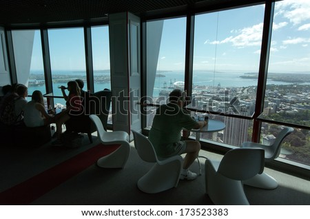 AUCKLAND, NZ - JAN 02: Visitors at the Sky Tower observation deck on Jan 02 2014.It's 328 metres (1,076ft) tall and it the tallest free-standing structure in the Southern Hemisphere.