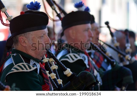 AUCKLAND,NZ - JUNE 01 2014:Pipe band celebrate the Queen's Birthday on the first Monday of June each year as the Queen of the United Kingdom being the head of state. - stock photo