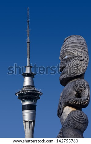AUCKLAND, NZ - MAY 27:Auckland Sky Tower against Maori sculpture on May 27 2013. The tower attracts an average of 1,450 visitors per day (over 500,000 per year). - stock photo