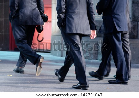 AUCKLAND, NZ - MAY 27:Businessmen on Queen Street on May 27 2013. 36% of NZ men working full-time worked 50 or more hours.