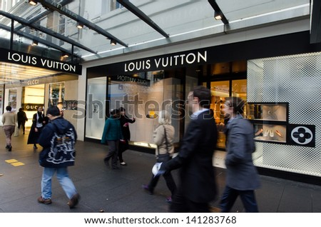 AUCKLAND,NZ - MAY 29:People passing by Louis Vuitton Shop on Queens street on May 29 2013.Louis Vuitton has been named the world's most valuable luxury brand for the last 6 years (2006-2012). - stock photo