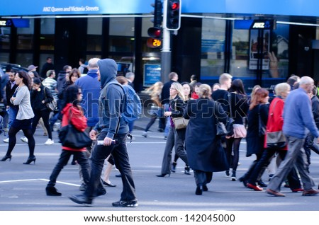 AUCKLAND, NZ - MAY 29:Traffic on Queen street  on May 29 2013.It's a major commercial thoroughfare in the Auckland CBD, New Zealand's main population center. - stock photo
