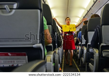 AUCKLAND - SEP 22 2014:Flight attendant. For planes with up to 19 passenger seats, no flight attendant is needed. For larger planes, one flight attendant per 50 passenger seats is needed. - stock photo