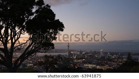 Auckland skyline aerial view as evening light fades, new Zealand - stock photo