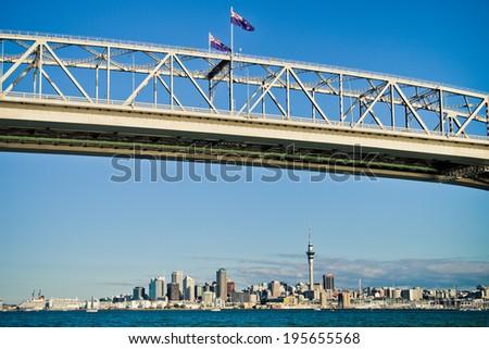 Auckland under the Harbour Bridge - stock photo