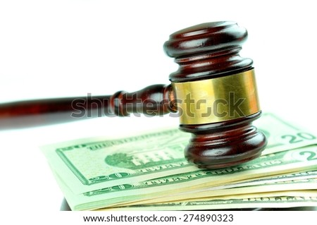 Auction concept with gavel on money background
