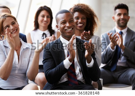 Audience Applauding Speaker At Business Conference - stock photo