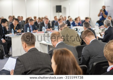 Audience at the conference hall. No recognizable faces - stock photo