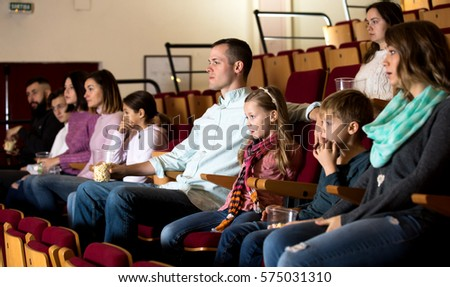 Audience attending movie night for comedy in cinema