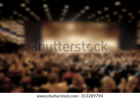 Audience in a theater, on a concert and applauding blurred - stock photo