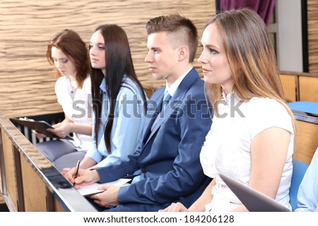 Audience listening to presentation at conference - stock photo