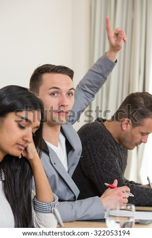 audience member at presentation or lecture wants to say something