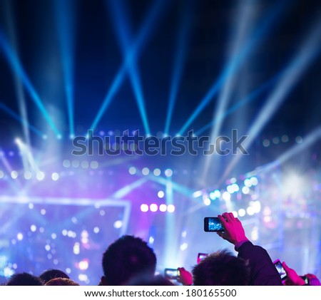 audience silhouettes at a live music concert  - stock photo