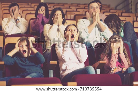 Audience watching movie night for horror in cinema