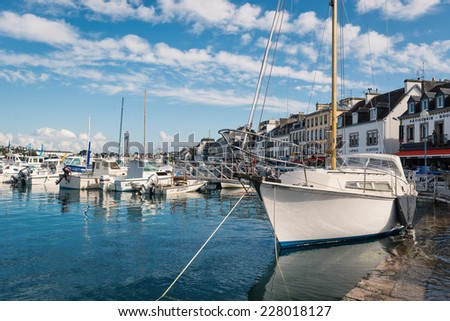 AUDIERNE, FRANCE - AUGUST 12, 2014: Harbor in a sunny day. Audierne lies on a peninsula at the mouth of the Goyen river and for centuries was a fishing village.