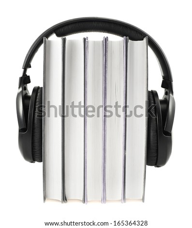 Audio-books concept composition as a stack of books with a headphones on it, isolated over white background - stock photo