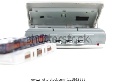 Audio cassette player with tapeAudio cassette player opened to display the cassette tape on a white background