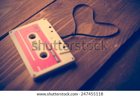 Audio cassette tape in the shape of heart. Retouching vintage. - stock photo