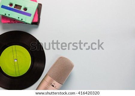 audio cassettes, microphone and tape recorder with copy space - stock photo