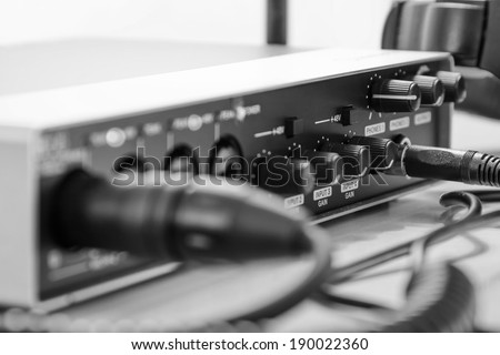 Audio interface and cables, home studio - processed colors - stock photo