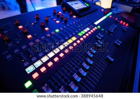 Audio mixer and microphone - stock photo