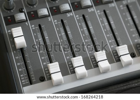 Audio mixer deck with knobs and selective focus - stock photo