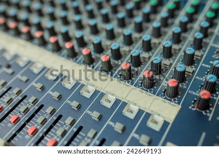 Audio mixing console closeup, music concept.