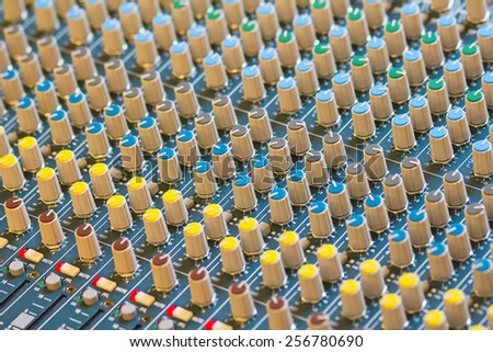 Audio mixing console closeup with shallo depth of field - stock photo